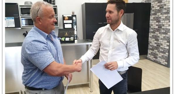 Visvaldis Troksa and Mattias Andersson at Contract signing